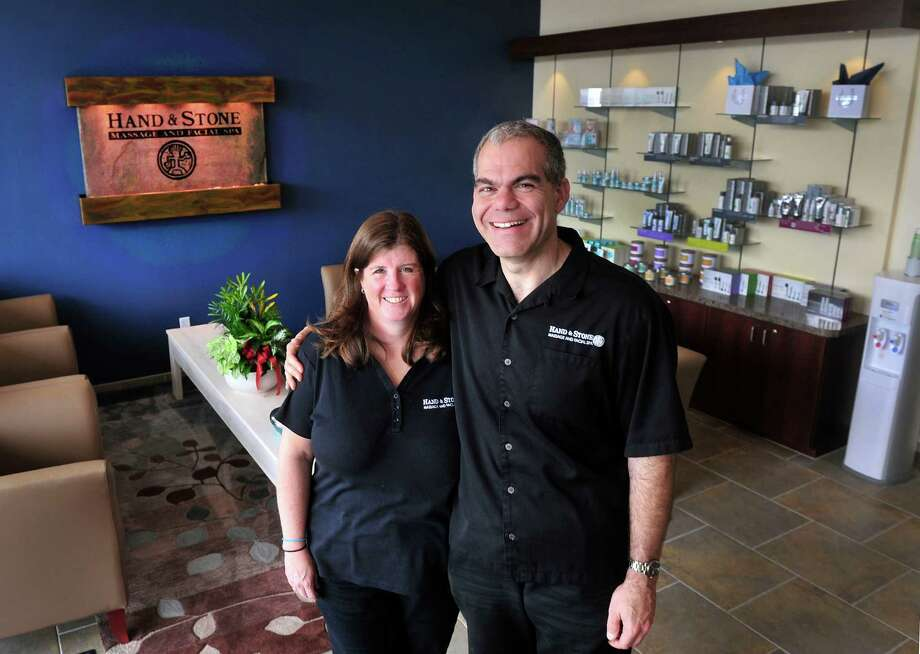 Marianne and Rob Durr stand inside Hand & Stone Massage and Facial Spa, the Brookfield, Conn., business they own, Friday, Aug. 30, 2013. Photo: Michael Duffy / The News-Times