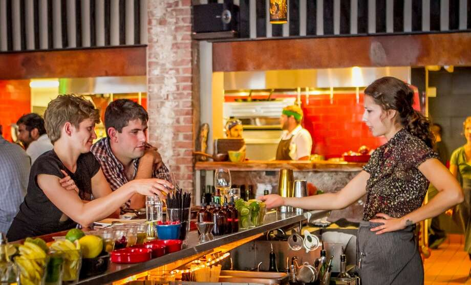 Bartender Zoe Carrasco talks with customers at Duende in Oakland. Photo: John Storey, Special To The Chronicle