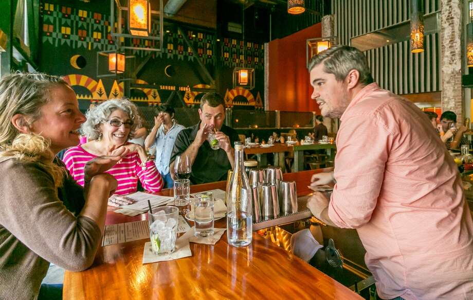 Bartender Yannick Gabadov talks with customers at Duende in Oakland. Photo: John Storey, Special To The Chronicle