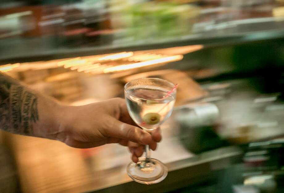 A martini on its way to a table at Duende in Oakland. Photo: John Storey, Special To The Chronicle