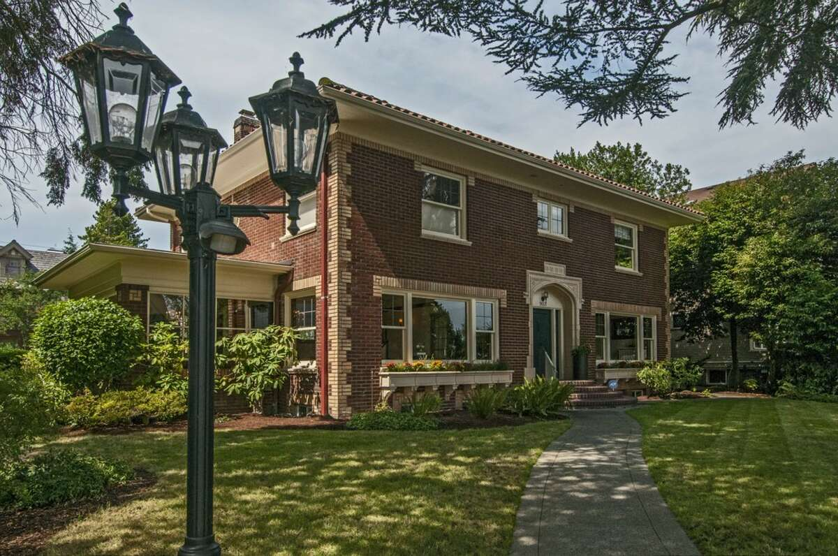 Capitol Hill is known for its Craftsman mansions, but it also features other styles, such as this brick Colonial, 903 22nd Ave. E. The 4,410-square-foot home, built in 1928, has five bedrooms, 3.5 bathrooms, a garden room, leaded glass, French doors, wrought iron, a theater, a bar and a two-car garage on an 8,640-square-foot lot. It's listed for $1.829 million.
