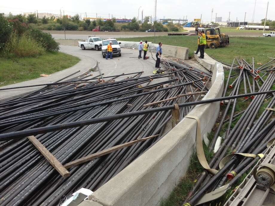 An overturned 18-wheeler has shut down the East Loop ramp at Clinton Drive. It appears to have been carrying a load of metal pipes. There are no injuries reported or fuel spills involved, according to Houston TranStar, and they are anticipating a two-hour delay for the load to be cleared and the ramp reopened.    Cody Duty/ Chronicle Photo: Cody Duty