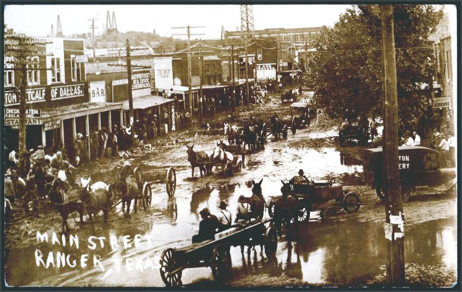 RANGER, TEXAS, circa 1910,  A real photo postcard shows a plethora of activity on the main street of Ranger, Texas around 1910,  Wagons, signs, flooding, animals, and oil wells are all visible in the image. (Photo by Transcendental Graphics/Getty Images) Photo: Getty Images