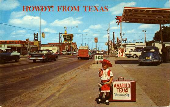 UNITED STATES - CIRCA 1900:  Postcard view of the nmotel and tourist district along route 66 in Amarilli, TexasA little cowgirl with a suitcase stands on the side of the busy street. Vintage cars and neon signs are visible.  (Photo by Lake County Museum/Getty Images) Photo: Getty Images