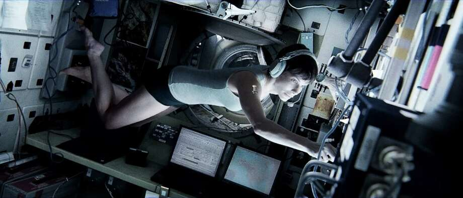 "This publicity photo released by Warner Bros. Pictures shows Sandra Bullock, left, as Dr. Ryan Stone in ""Gravity."" (AP Photo/Courtesy Warner Bros. Pictures) Photo: Associated Press / Courtesy Warner Bros. Pictures"