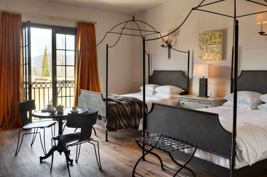 The 13 guest rooms have wrought-iron beds with 500-thread count linens, flat screen TV, iPad concierge, and French doors/windows with scenic views; many include patios and fireplaces. Bathrooms have a rain showerhead and/or soaking tub and Hermes toiletries. Photo: GETZCREATIVE