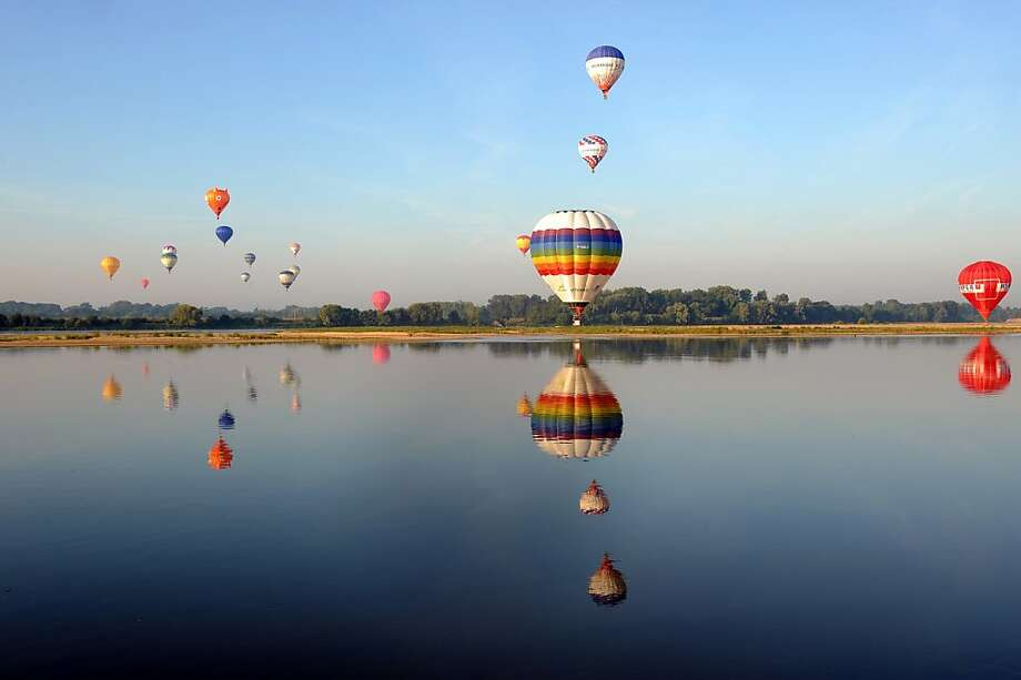 River rising: Hot air balloons fly over the Loire during the French Air-Balloon Championship in Brissac-Quincé. Photo: Jean-Francois Monier, AFP/Getty Images