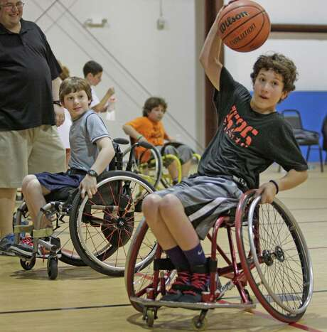 Aaron, left, and Peter Berry played basketball at a fundraiser held for them and sister, Willa. Photo: Melissa Phillip, Staff / © 2013  Houston Chronicle