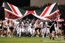 The Churchill Chargers take to field to start the second half of the 30th annual Gucci Bowl between Churchill and Clark at Farris Stadium on Thursday, Aug. 29, 2013. MARVIN PFEIFFER/ mpfeiffer@express-news.net