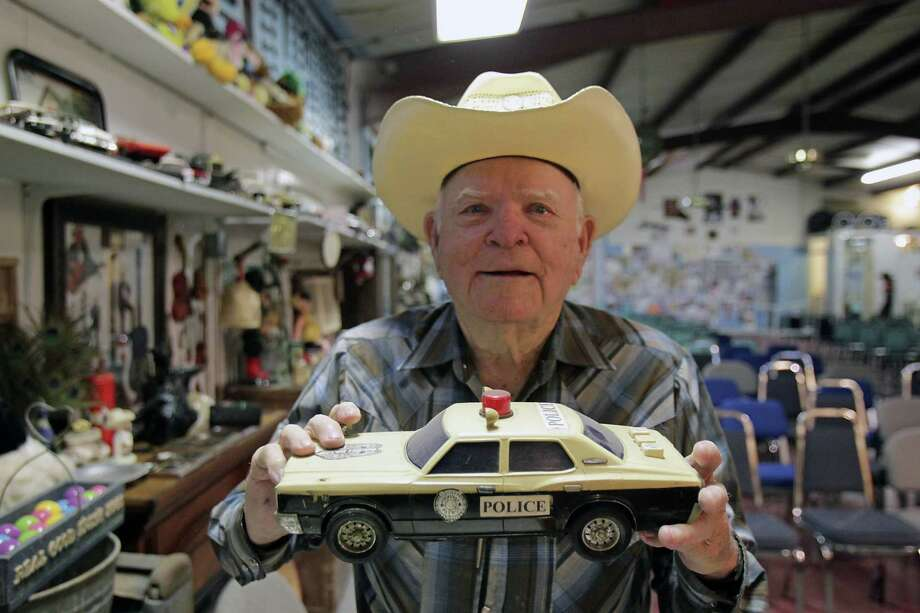 """C.P. """"Buck"""" Sloan's Buckshot Jamboree houses his collection of memorabilia, such as this toy police car. Photo: James Nielsen, Staff / © 2013  Houston Chronicle"""