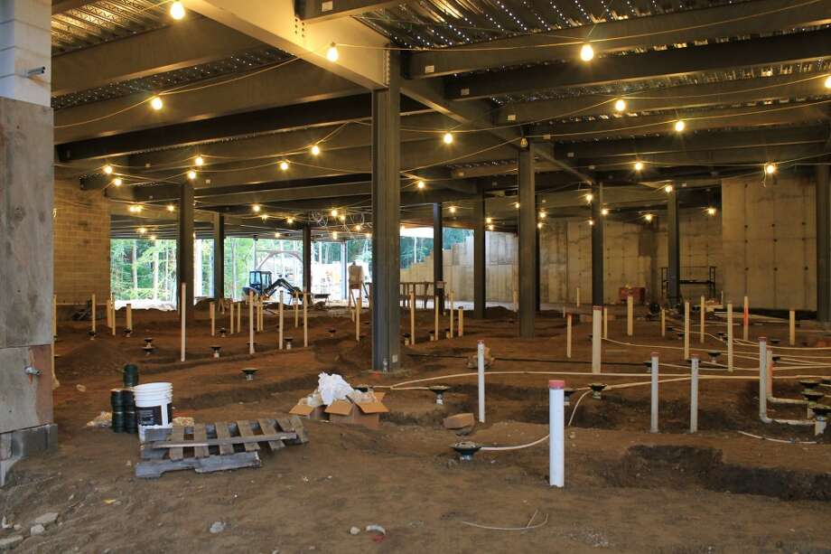 The under-slab utilities are being installed in the locker room area.