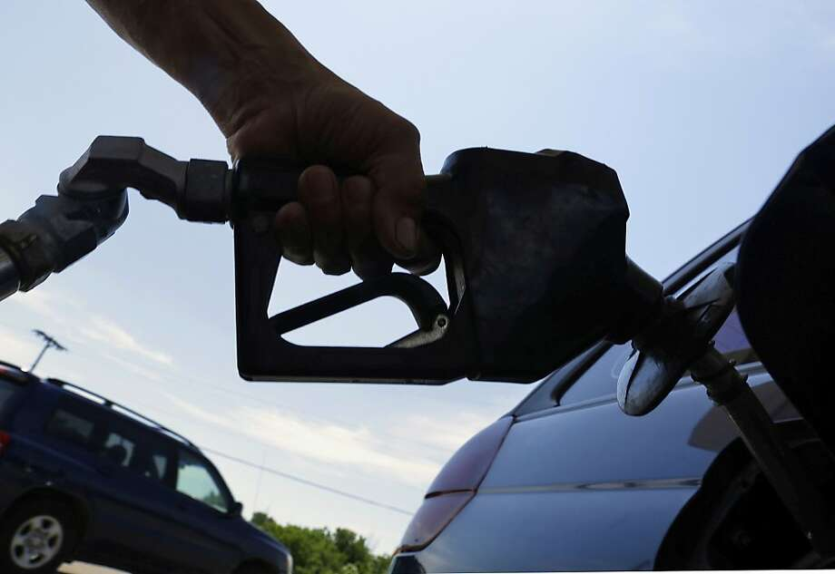 California's average price for regular gas stood at $3.82 on Friday. A year ago, it was $4.15. Photo: Seth Perlman, Associated Press