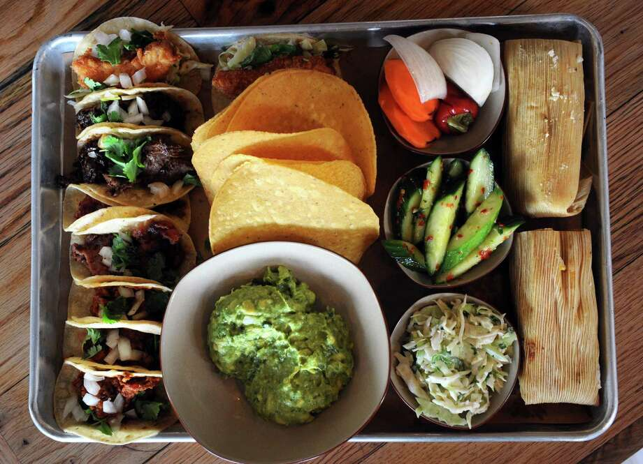 The large taco tray, a chef's selection of tacos, guacamole, tamales and sides, at Bartaco at 20 Wilton Road in Westport, Conn. Photo: Autumn Driscoll / Connecticut Post