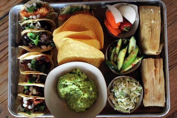 The large taco tray, a chef's selection of tacos, guacamole, tamales and sides, at Bartaco at 20 Wilton Road in Westport, Conn.