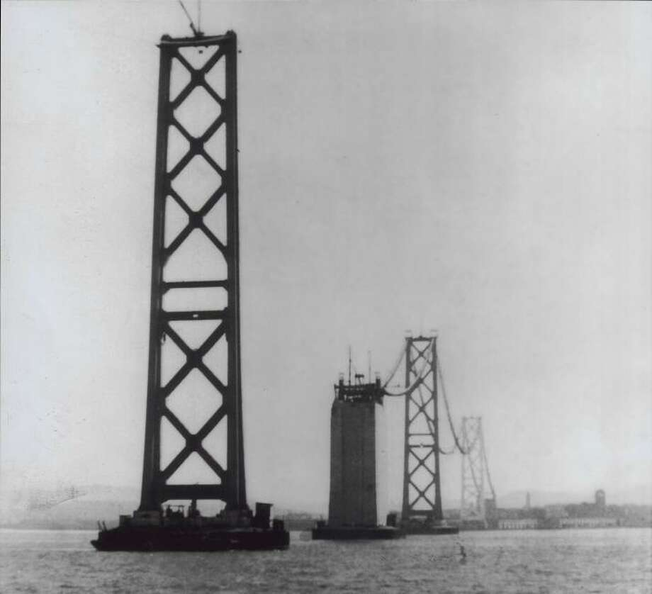 1935: The western span towers, as crews add suspension cables. Looking at this, it feels like I accidentally walked in on the Bay Bridge when it was naked. Photo: Courtesy Of, Courtesy Harry Fogle