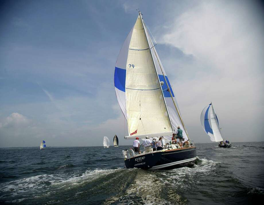 The crew of Kyrie from Centerport, New York, competes in the 2013 Vineyard Race, which began from Stamford Yacht Club on Friday, August 30, 2013. Photo: Lindsay Perry / Stamford Advocate