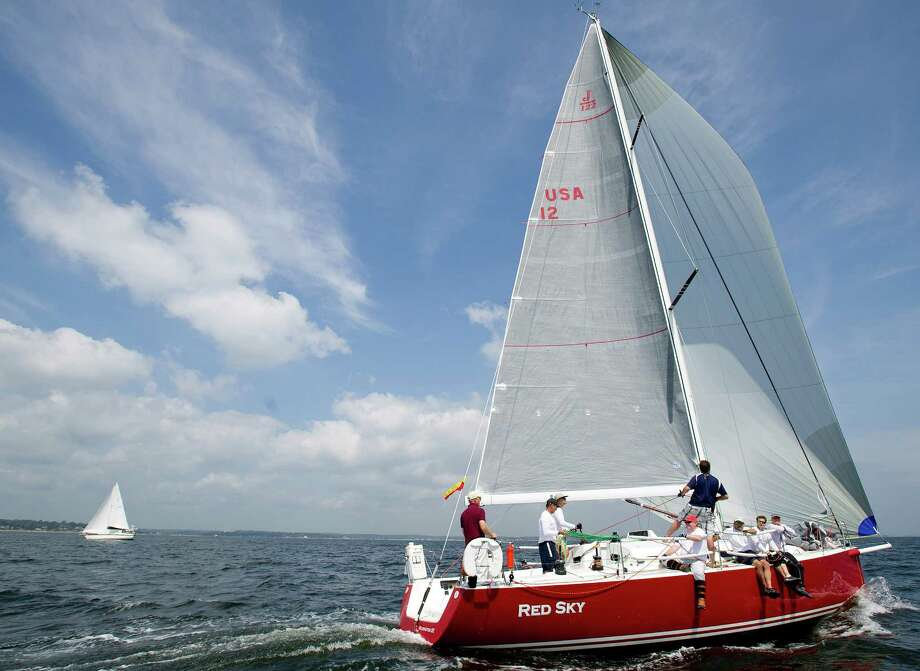 The crew of Red Sky from Red Bank, NJ, competes in the 2013 Vineyard Race, which began from Stamford Yacht Club on Friday, August 30, 2013. Photo: Lindsay Perry / Stamford Advocate