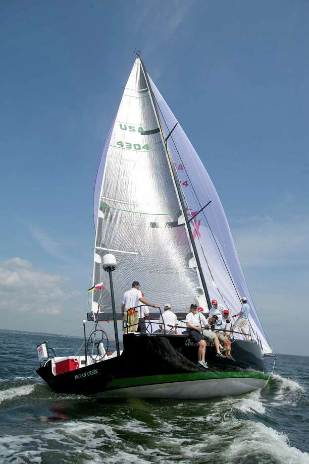 The crew of Christopher Dragon from Mamaroneck, NY, competes in the 2013 Vineyard Race, which began from Stamford Yacht Club on Friday, August 30, 2013. Photo: Lindsay Perry / Stamford Advocate