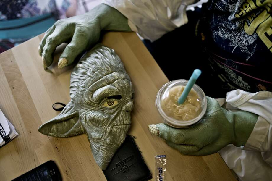 Michigan: Carl Williams takes a break from walking around downtown Midland, Mich. dressed as Yoda. Photo: Sean Proctor, Associated Press