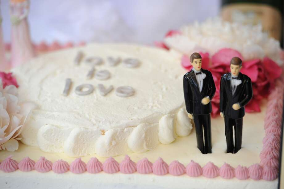 California: A wedding cake with a male couple is seen at The Abbey restaurant at a celebration of the over 100 same-sex marriages performed  in West Hollywood, California.  The US government on August 29, 2013 announced that legally married gay couples will be treated the same as married couples for federal tax purposes. The decision applies to legally married same-sex couples whether they live in a state that recognizes the marriage or not, the US Treasury Department and the Internal Revenue Service said in a statement. Photo: Robyn Beck, AFP/Getty Images
