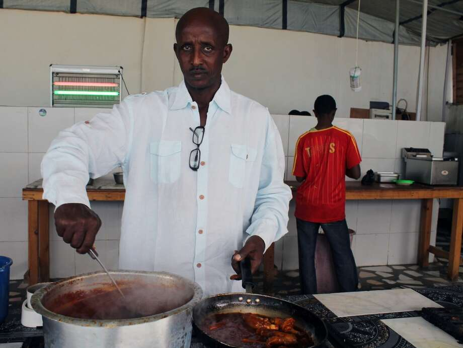 "Somalia: Ahmed Jama a British Somali chef and one of last year's TEDx Mogadishu speakers, cooking food at his hotel in Mogadishu, Somalia. Ahmed spoke last year and will speak again this year. He said last year's talk ""connected me to the world."" The talk won him an invitation to a cooking event in Denmark. The short talks by artists and intellectuals at events known as TEDx have been held 7,500 times in more than 150 countries, but there may not be an event more challenging or dangerous as the TEDx talk being held in Mogadishu this Saturday. Then again, there may be no city in the world that needs its smartest and strongest voices heard as much as Somalia's capital, which is clawing its way forward to move beyond its bombs-and-bullets past. Photo: Farah Abdi Warsameh, Associated Press"