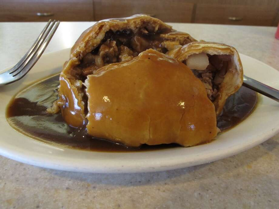 Montana: Ameat-filled pasty with gravy from Joe's Pasty Shop in Butte, Montana. The shop is one of a handful that serve the meat-and-potato pie that immigrant miners brought a century ago and has remained a part of Butte's culinary culture. Photo: Matt Volz, Associated Press