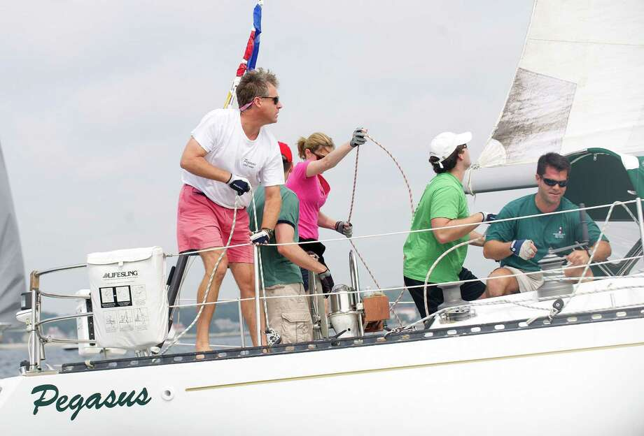 The crew of the Wilton-based Pegasus compete in the 2013 Vineyard Race beginning from Stamford Yacht Club on Friday, August 30, 2013. Photo: Lindsay Perry / Stamford Advocate