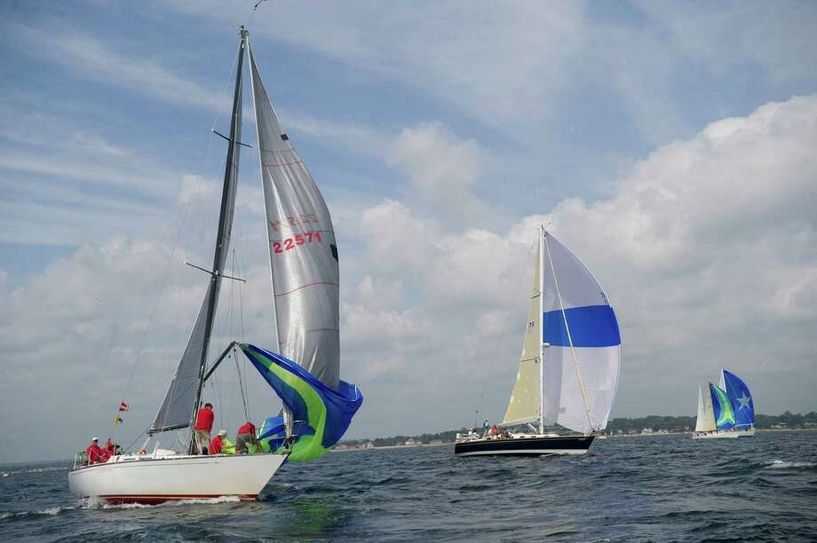 The crew of Letting Go from Croton on Hudson, New York, left, competes in the 2013 Vineyard Race, which began from Stamford Yacht Club on Friday, August 30, 2013. Photo: Lindsay Perry / Stamford Advocate