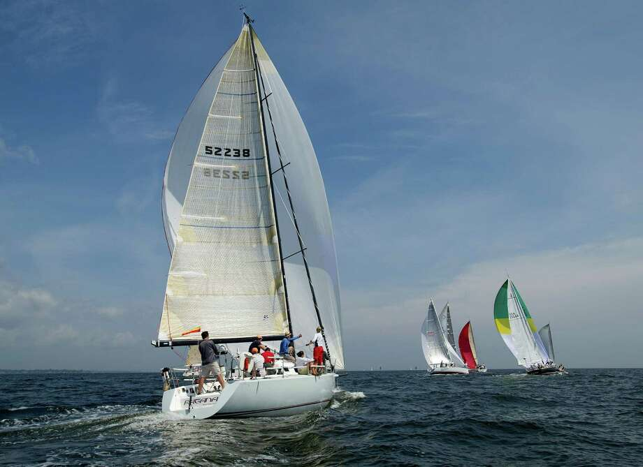 The crew of Ragana from Westport, Conn., competes in the 2013 Vineyard Race, which began from Stamford Yacht Club on Friday, August 30, 2013. Photo: Lindsay Perry / Stamford Advocate