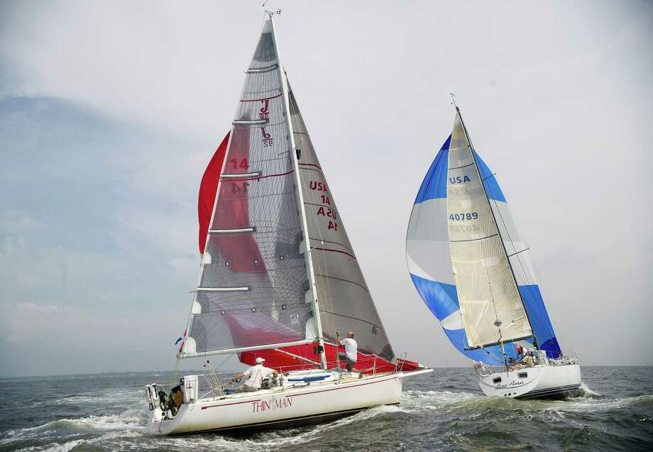 From left, the Thin Man from Brooklyn, New York, and the Lora Ann from Larchmont, New York, compete in the 2013 Vineyard Race, which began from Stamford Yacht Club on Friday, August 30, 2013. Photo: Lindsay Perry / Stamford Advocate