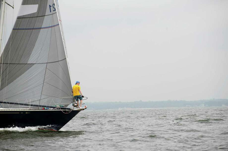 The crew of the Rowayton-based Glim prepares to compete in the 2013 Vineyard Race beginning from Stamford Yacht Club on Friday, August 30, 2013. Photo: Lindsay Perry / Stamford Advocate