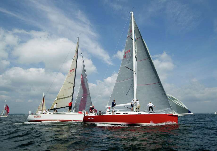 From left, the crews of Avalanche from Sea Cliff, New York, and Red Sky, from Red Bank, New Jersey, compete in the 2013 Vineyard Race, which began from Stamford Yacht Club on Friday, August 30, 2013. Photo: Lindsay Perry / Stamford Advocate