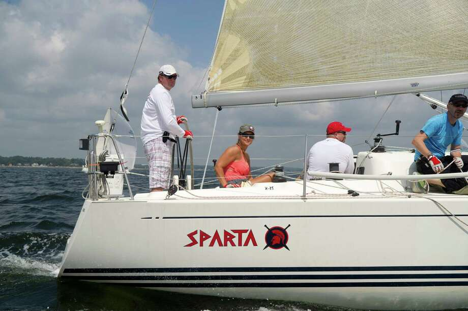 The crew of Sparta from Newport, Rhode Island, competes in the 2013 Vineyard Race, which began from Stamford Yacht Club on Friday, August 30, 2013. Photo: Lindsay Perry / Stamford Advocate