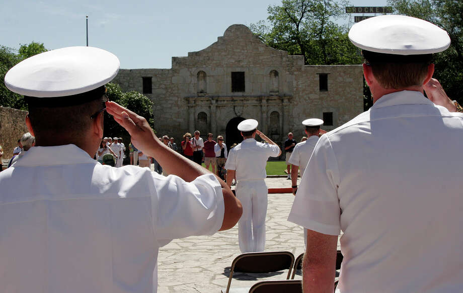Crew members of the USS San Antonio salute during the playing of The Star Spangled Banner during Navy Day at the Alamo, part of Fiesta activities in San Antonio, Thursday morning, April 25, 2007. Photo: J. MICHAEL SHORT, SPECIAL TO THE EXPRESS-NEWS / THE SAN ANTONIO EXPRESS-NEWS