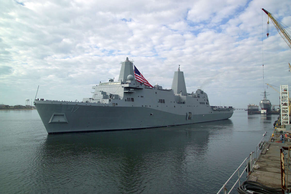 USS San Antonio departs Mississippi for its homeport - Norfolk - for the Christmas / New Years holiday period. The USS San Antonio rode out the storm when Katrina hit the Mississippi coast. After the storm the crew got off the ship and began to help clean up the area.