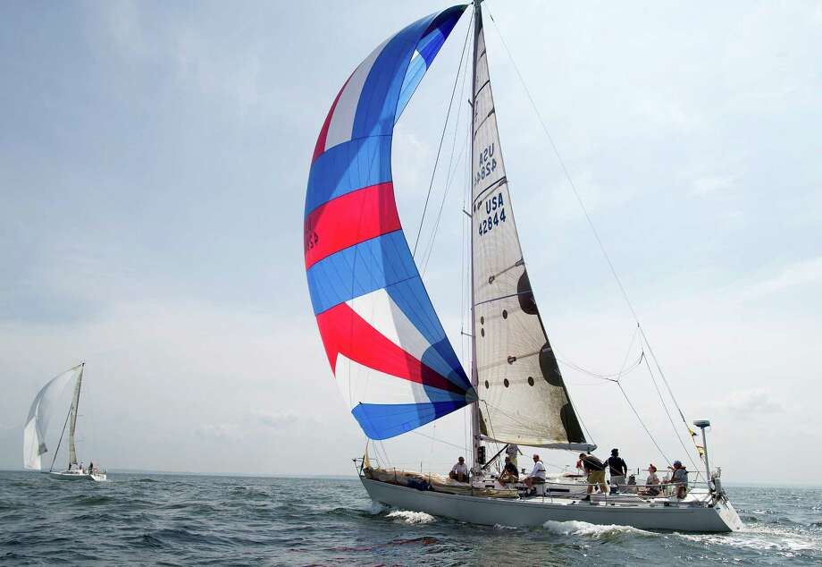 The crew of Charlie V from Glen Cove, NY, competes in the 2013 Vineyard Race, which began from Stamford Yacht Club on Friday, August 30, 2013. Photo: Lindsay Perry / Stamford Advocate