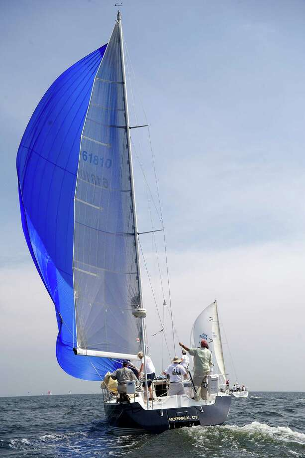 The crew of Arabesque from Norwalk, Conn., competes in the 2013 Vineyard Race, which began from Stamford Yacht Club on Friday, August 30, 2013. Photo: Lindsay Perry / Stamford Advocate