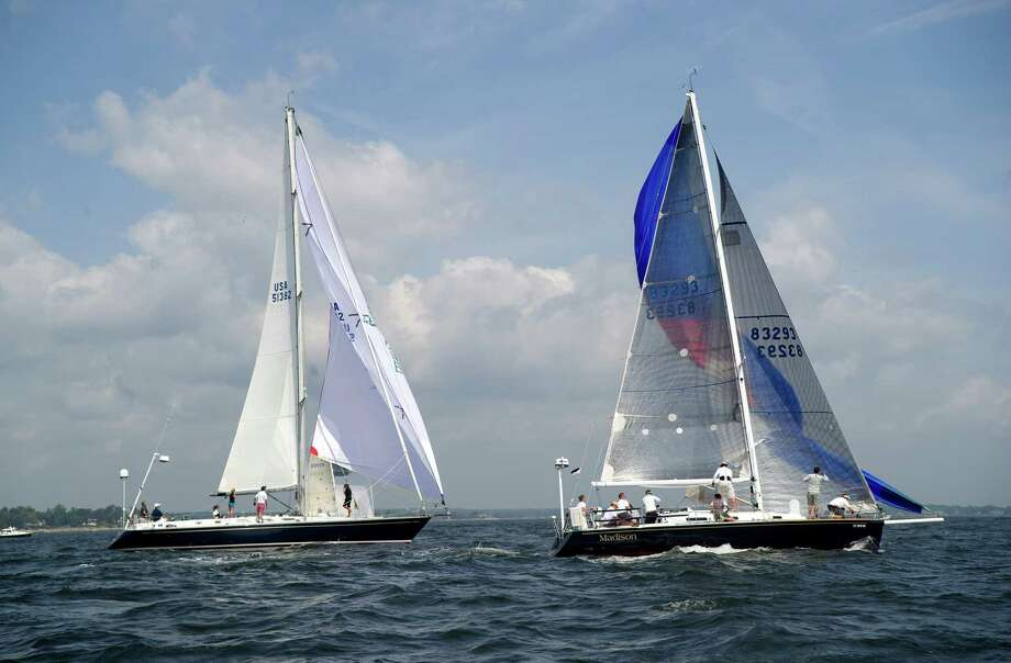 From left, the crews of SKYE from New York, NY, and Madison, from Redding, Conn., compete in the 2013 Vineyard Race, which began from Stamford Yacht Club on Friday, August 30, 2013. Photo: Lindsay Perry / Stamford Advocate