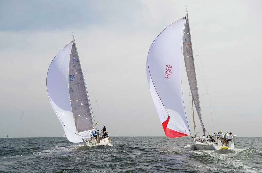 From left, the crews of Pax 3 from Bedford, New York, and Loki, from Southport, Conn., compete in the 2013 Vineyard Race, which began from Stamford Yacht Club on Friday, August 30, 2013. Photo: Lindsay Perry / Stamford Advocate