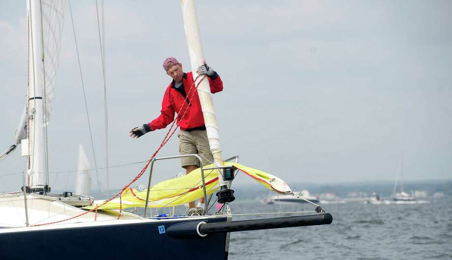 The crew of Sweet Caroline from Woodside, NY, competes in the 2013 Vineyard Race, which began from Stamford Yacht Club on Friday, August 30, 2013. Photo: Lindsay Perry / Stamford Advocate