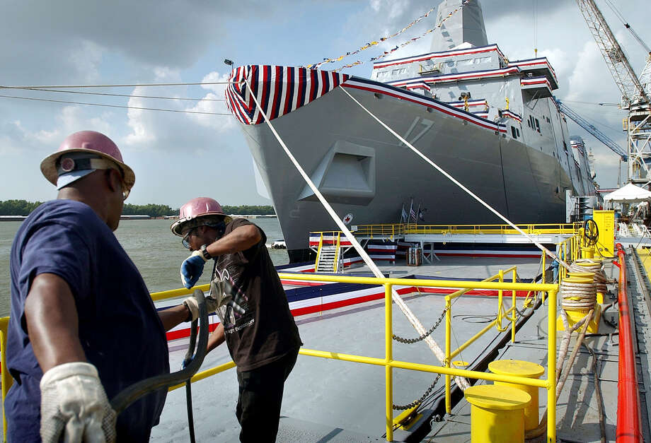 Shipyard workers at Northrop Grumman Ship sytems in Avondale get the finishing touches done on the christening site for a new amphibious ship to be called the USS San Antonio Friday, July 18, 2003. Sen. Kay Bailey Hutchinson, R-Texas, will christen the ship today at the site on the Mississippi River near New Orleans.  Photo: TOM REEL, SAN ANTONIO EXPRESS-NEWS / SAN ANTONIO EXPRESS-NEWS