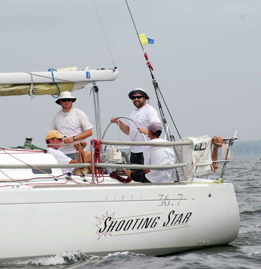 The crew of the Larchomont, NY-based Shooting Star prepares to compete in the 2013 Vineyard Race beginning from Stamford Yacht Club on Friday, August 30, 2013. Photo: Lindsay Perry / Stamford Advocate