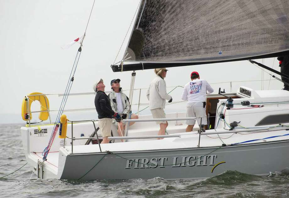 The crew of First Light prepares to compete in the 2013 Vineyard beginning from Stamford Yacht Club on Friday, August 30, 2013. Photo: Lindsay Perry / Stamford Advocate