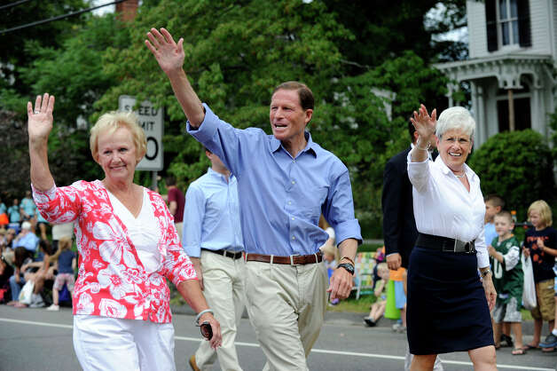In this photo from last year's Labor Day Parade, Newtown, Conn.,  First Selectman Pat Llodra, left, U.S. Senator Richard Blumenthal and Lt. gov. Nancy Wyman, wave to spectators. Photo: Carol Kaliff / The News-Times
