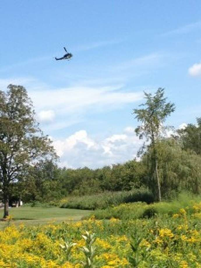 A State Police Helicopter flies over the Town of Kingsbury searching for plots of illegally grown marijuana on Wednesday August 28, 2013. (Washington County Sheriff's Office)
