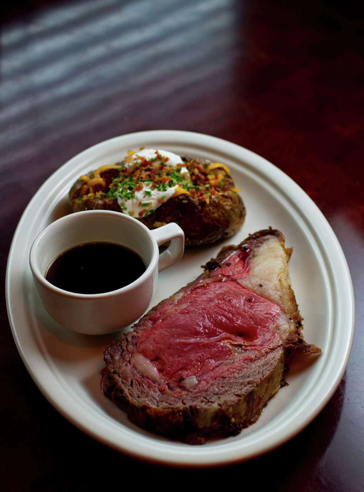 The Laurenzo family, owners of El Tiempo Cantina restaurants and Laurenzo's on Washington, plan to open a second Laurenzo's at 1910 Bagby in the former Republic Smokehouse location in Midtown. They expect to open before the Super Bowl. Shown: The Prime Rib with au jus and a loaded baked potato at Laurenzo's, 4412 Washington.