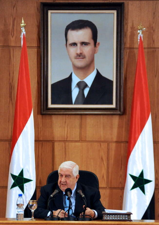 "Walid Muallem serves as Syrian foreign minister. In many ways, he is the spokesman to the world for the Assad regime. On August 27, 2013, Muallem said the government of Assad, which has been fighting an insurgency for the past 29 months, had defenses that would ""surprise"" the world. Photo: STR, AFP/Getty Images / 2013 AFP"
