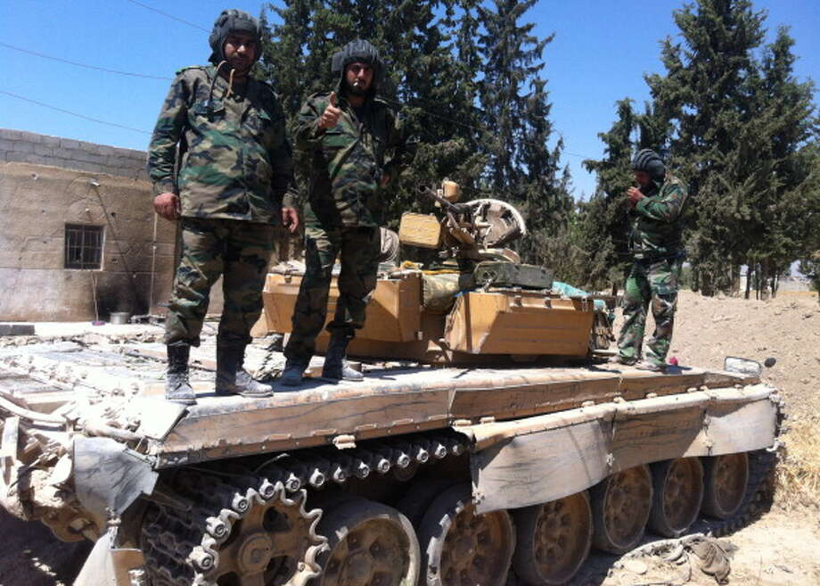The Syrian Armed Forces, led by Assad as commander in chief, is comprised of an army, navy, air force and air defense force. Their weapons and equipment stockpile is largely Russian-built, including Cold War surplus. Photo: AFP, AFP/Getty Images / 2013 AFP