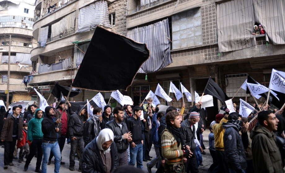 "Also among the rebels opposing the Syrian government is Jabhat al-Nusra (""The Support Front for the People of Greater Syria""), also known as the al-Nusra Front.  The al Qaeda-aligned Sunni Islamic group has been designated as a terrorist organization by the U.S. and United Kingdom, among other nations. Photo: AAMIR QURESHI, AFP/Getty Images / 2013 AFP"