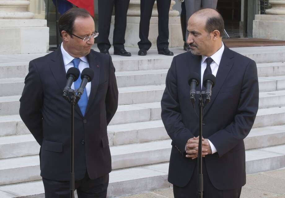 France's President Francois Hollande (seen here, at left with Syrian National Coalition head Ahmad al-Jarba) has pledged his nation's support to an U.S. action against Syria. Photo: Michel Euler, ASSOCIATED PRESS